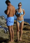 Anna Heinrich spotted in a light blue bikini as she enjoys a relaxing day at the Bondi beach with Tim Robards in Sydney, Australia