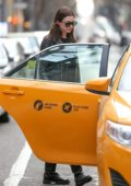 Anne Hathaway and Adam Shulman take a cab with their son Jonathan on a family outing in New York City