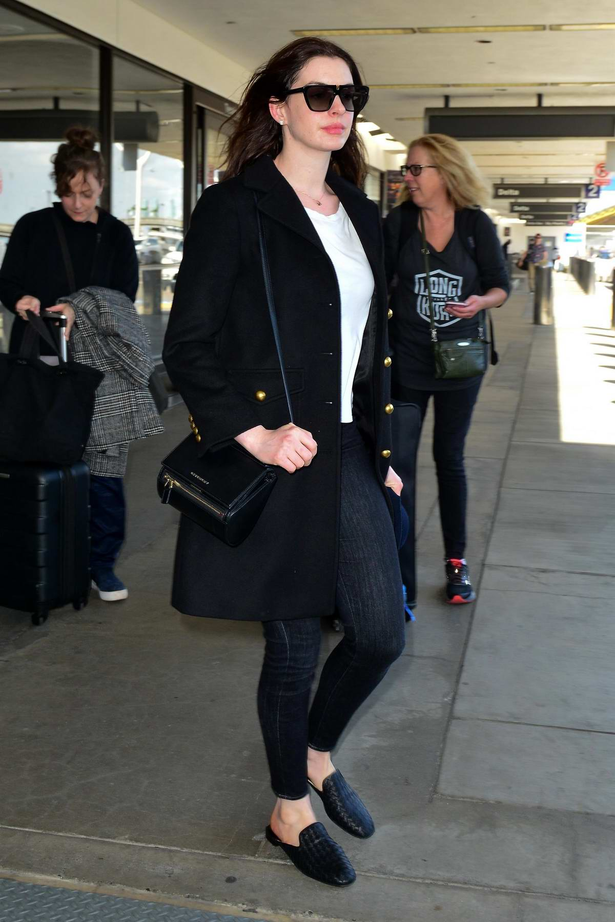 Anne Hathaway looks stunning as she makes her way through the LAX airport in Los Angeles