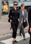Anne Hathaway seen wearing black denim jumpsuit as she touches down at Heathrow Airport in London, UK