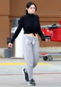 Ariel Winter flashes her abs in a cropped black turtleneck and grey sweatpants while out for Easter shopping at Target in Los Angeles
