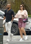 Ashley Graham wears a soft pink wool top and mauve silk mini-skirt while out for a stroll in Tribeca, New York City