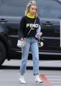 Ashley Tisdale rocks Fendi turtleneck sweater with a Fendi purse while dropping off few boxes in West Hollywood, Los Angeles