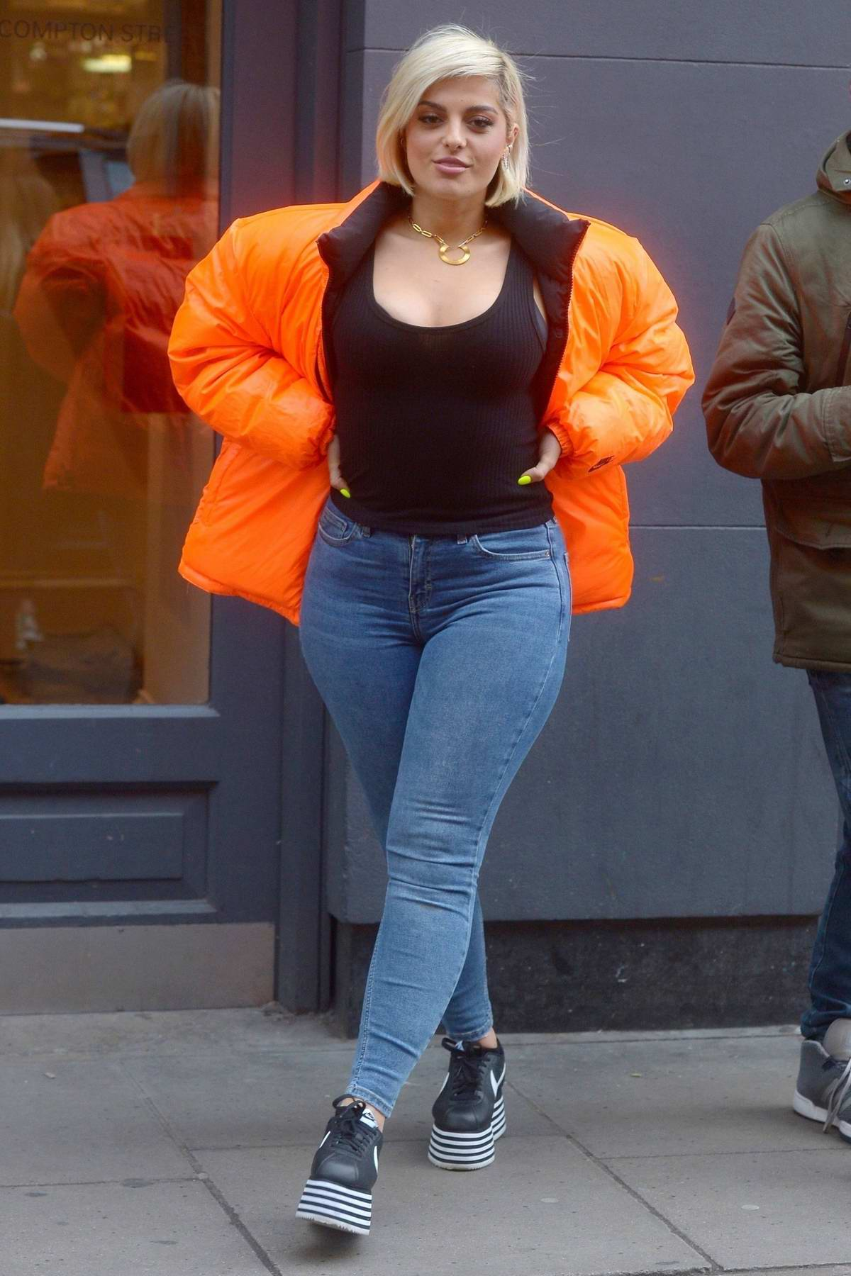 Bebe Rexha stands out in orange puffer jacket while out in