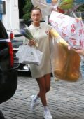 Bella Hadid arrives with birthday balloons and flowers at Gigi's apartment in New York City