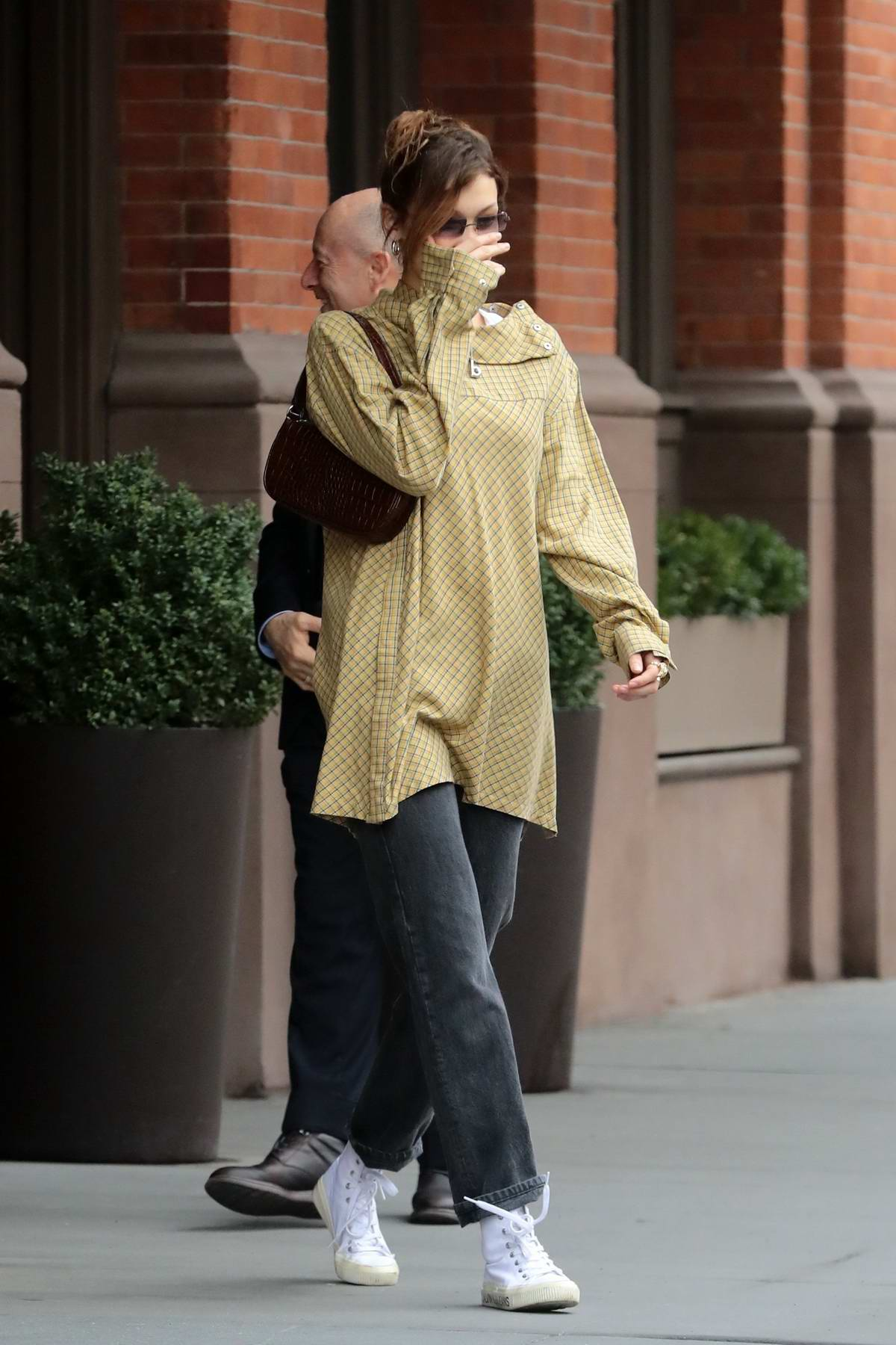 Bella Hadid sports her lighter colored hair as she heads to her ride in New York City