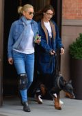 Bella Hadid steps out with her mother Yolanda Hadid and her dog in New York City