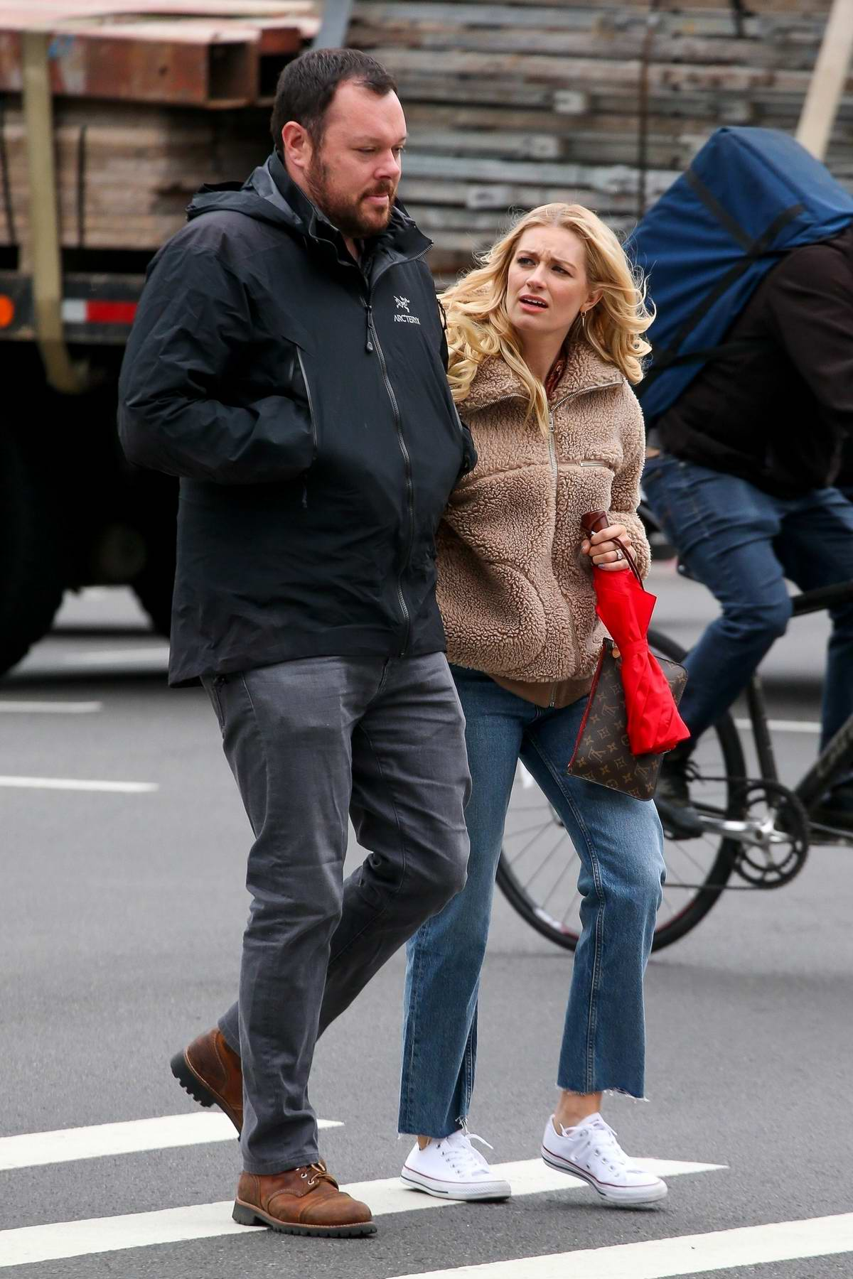 Beth Behrs and husband Michael Gladis steps out for a walk in New York City