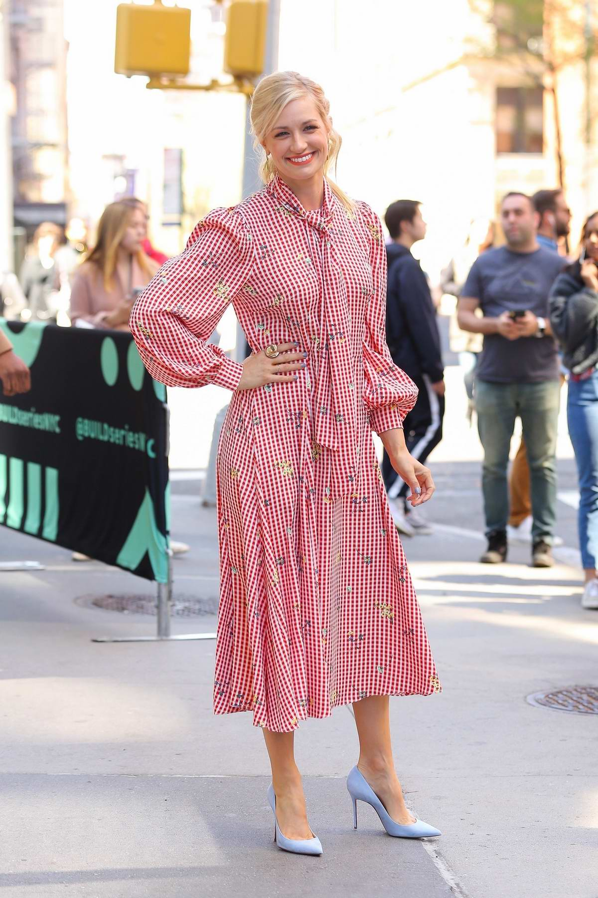 Beth Behrs looks pretty in a pink spring dress as she visits AOL Build Series in New York City
