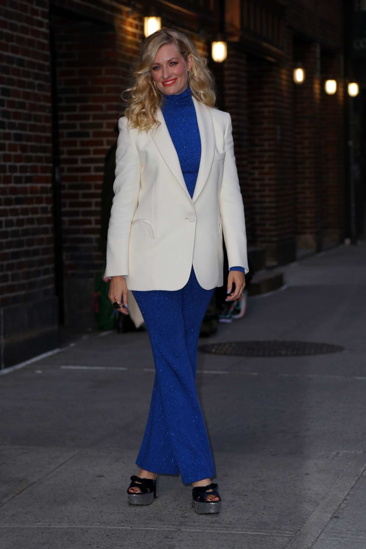 Beth Behrs wears a white blazer with a blue outfit while visiting 'The Late Show with Stephen Colbert' in New York City