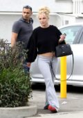 Britney Spears keeps it casual in a black sweater and grey sweatpants during a visit to a Tan salon in Thousand Oaks, California