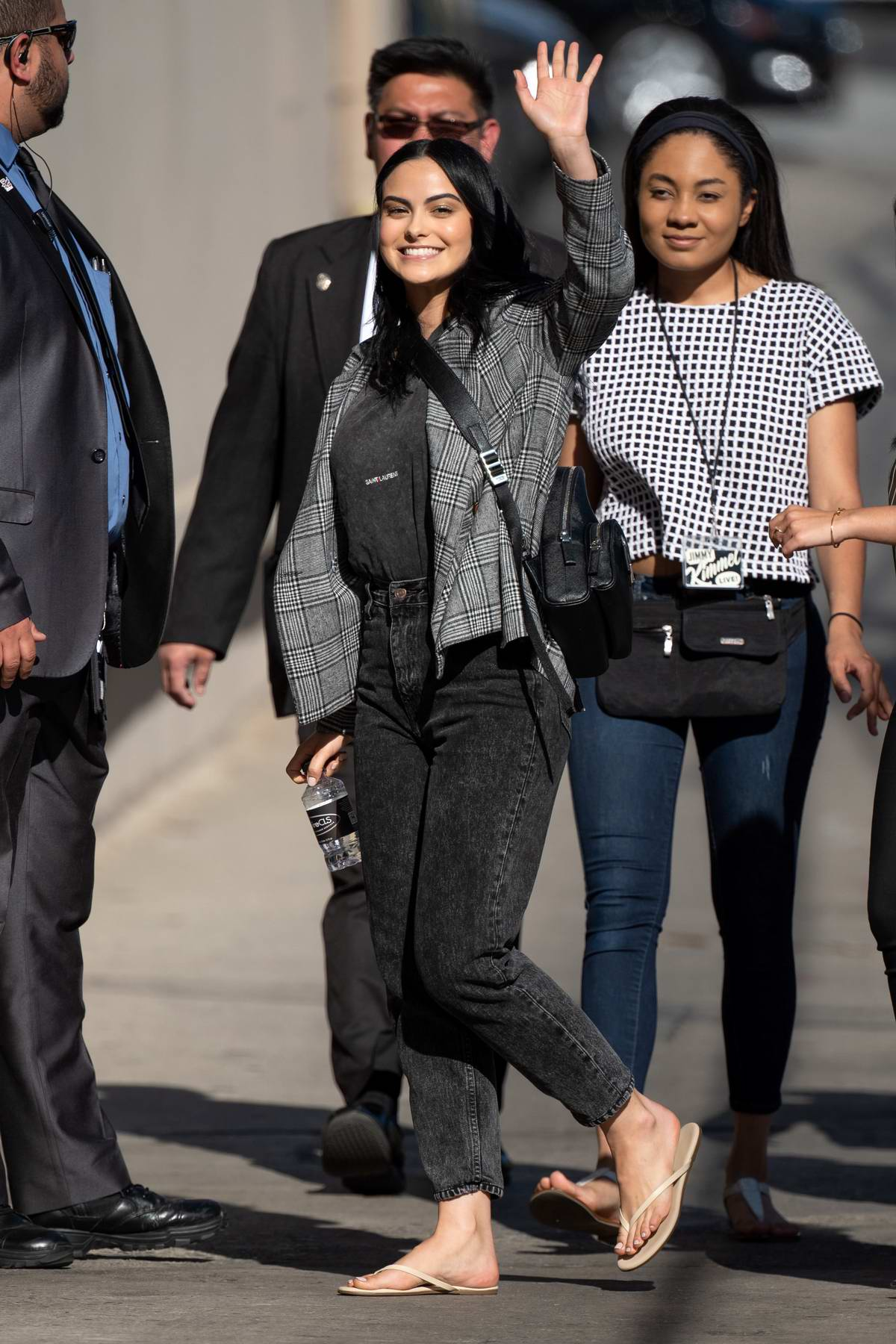 Camila Mendes waves for the camera as she arrives for her appearance on 'Jimmy Kimmel Live!' in Hollywood, California
