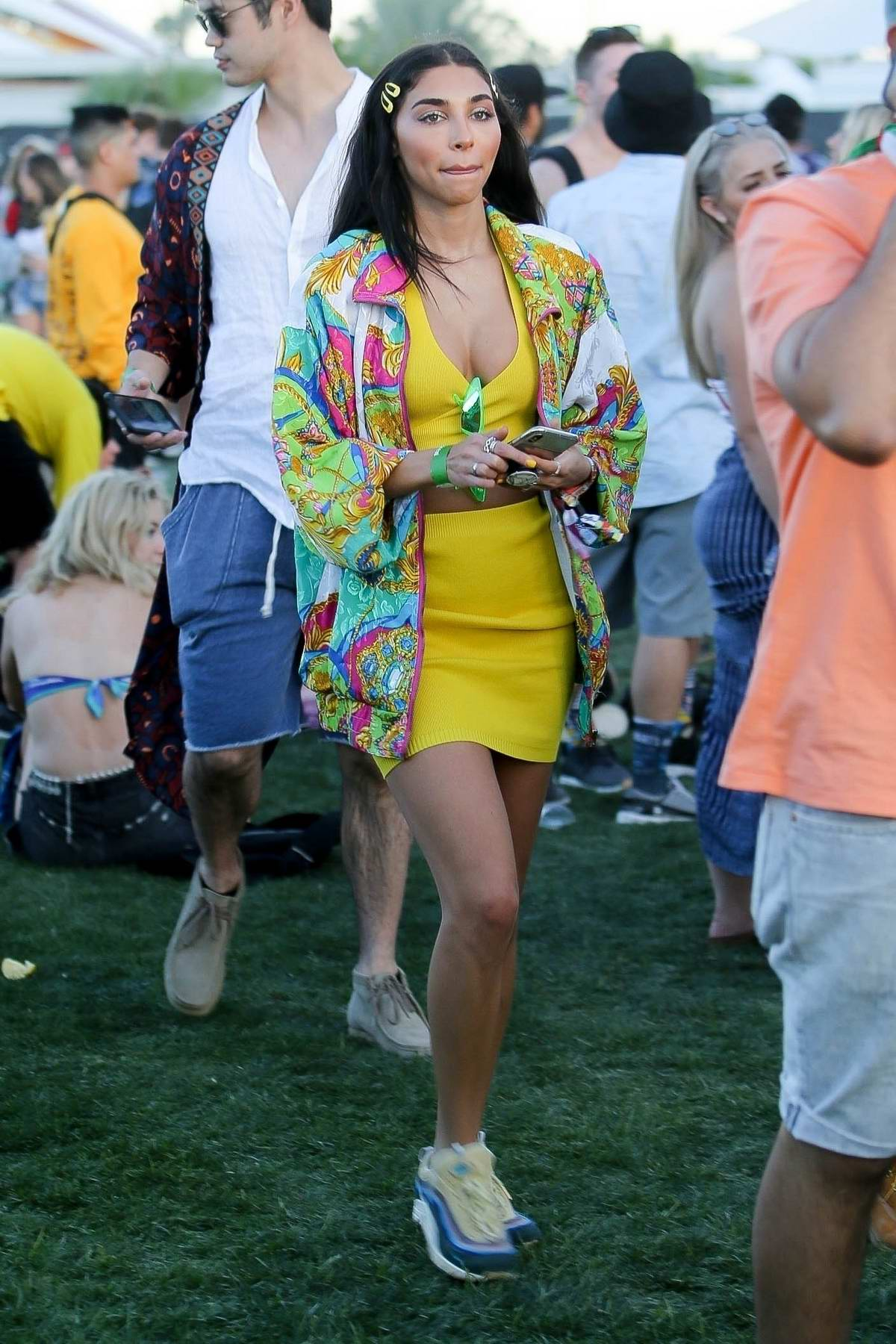 Chantel Jeffries and Ross Butler exploring the fair grounds with friends at Coachella in Indio, California