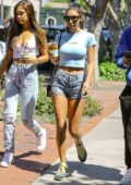 Chantel Jeffries shows off her summer style in a baby blue crop top and denim shorts while out with friends in Los Angeles