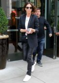 Charlize Theron looks sleek in a black blazer, white top and black leather pants while promoting 'Long Shot' In New York City