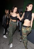 Charlotte Lawrence rocks a black crop top and olive green pants during a night out with friends at Delilah in West Hollywood, Los Angeles