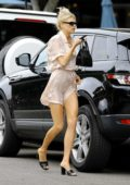 Charlotte McKinney braves the wind as she steps out in a short silk dress to run errands in Los Angeles