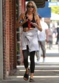 Charlotte McKinney walks back to her car after a yoga class in Santa Monica, California