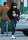 Chloe Grace Moretz steps out in a black hoodie and blue leggings as she stops at a grocery store in Los Angeles