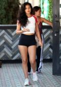 Cindy Kimberly rocks a white crop top and black short shorts while to lunch with friends at Tocaya in West Hollywood, Los Angeles