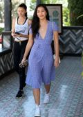 Cindy Kimberly smiles for the cameras following lunch with friends on the Sunset Strip at Tocaya in West Hollywood, Los Angeles