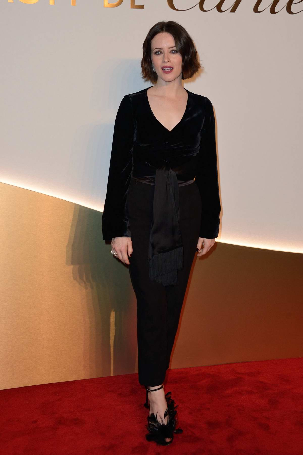 Claire Foy attends Clash De Cartier Photocall at La Conciergerie in Paris, France