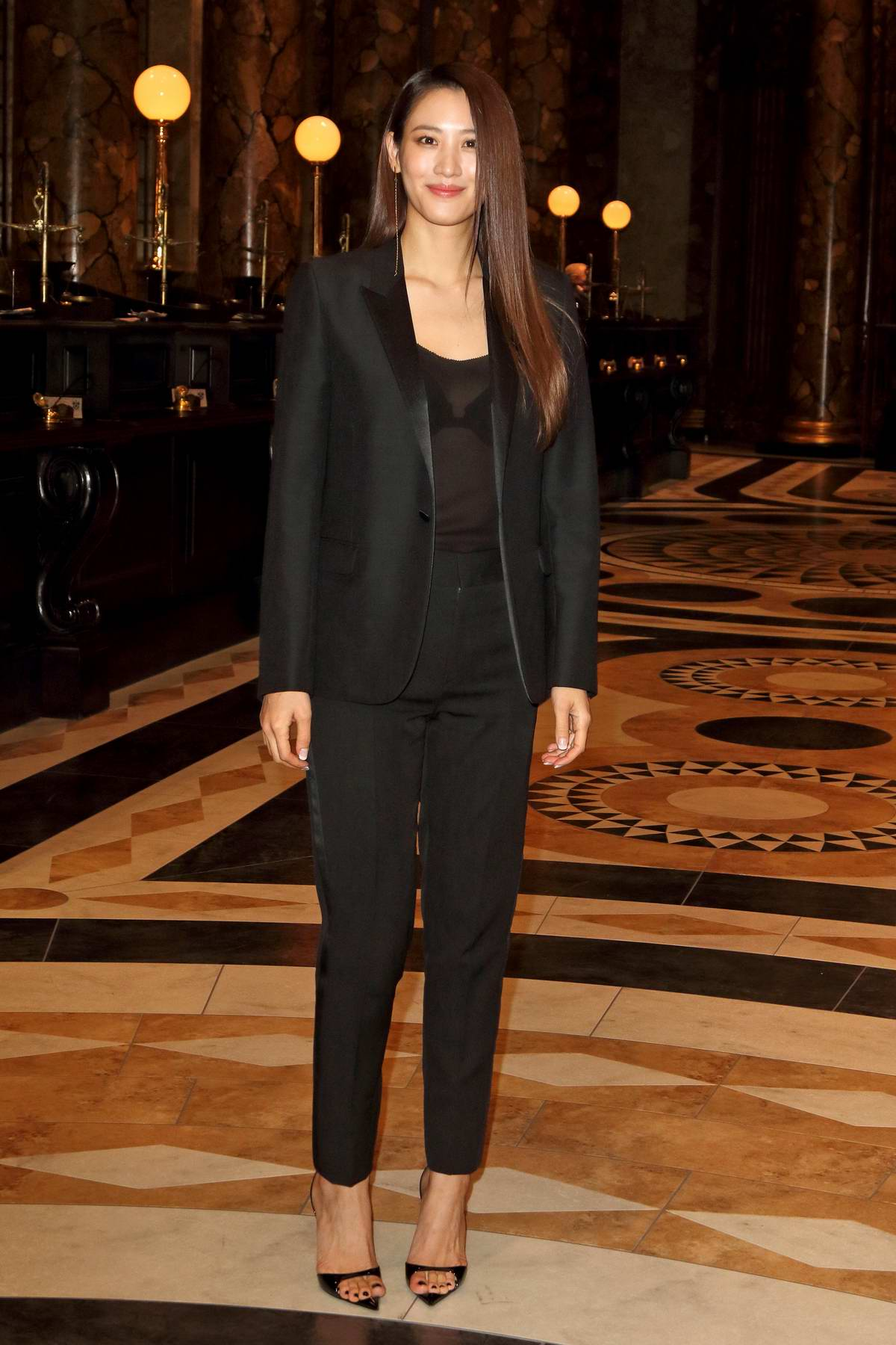 Claudia Kim attends the launch event for the Original Gringotts Wizarding Bank at Warner Bros Studio Tour in Watford, UK