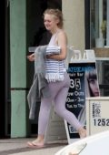 Dakota Fanning spotted in a lavender crop top with matching leggings as she leaves after her workout in Los Angeles