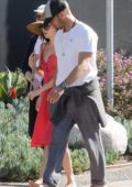 Dakota Johnson and Chris Martin steps out barefoot to walk their dog in Malibu, California