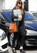 Dakota Johnson keeps it casual in all black while visiting a hair salon in Los Angeles