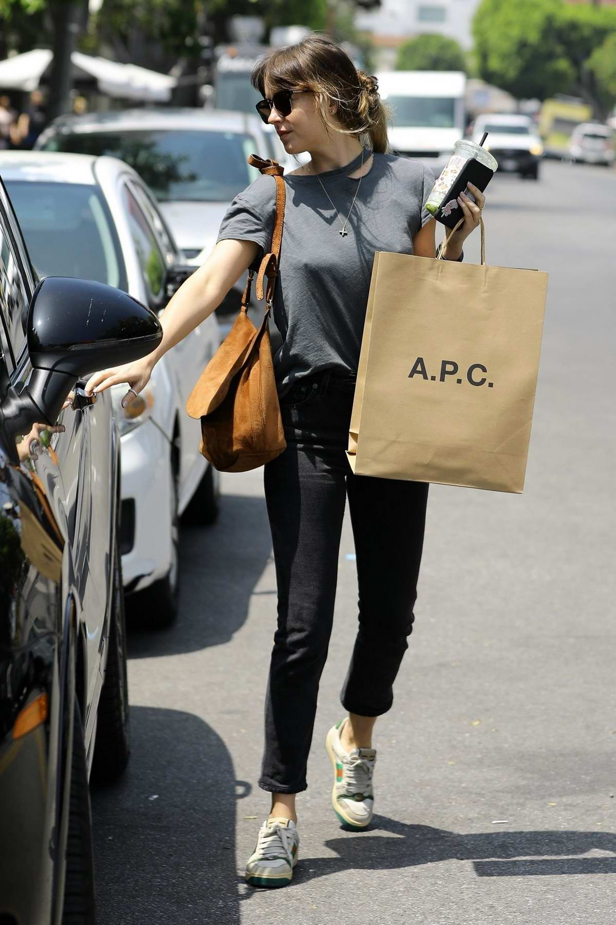 49716c90e dakota johnson wears grey top, black jeans and gucci sneakers during a  shopping trip to apc in los angeles-260419_7