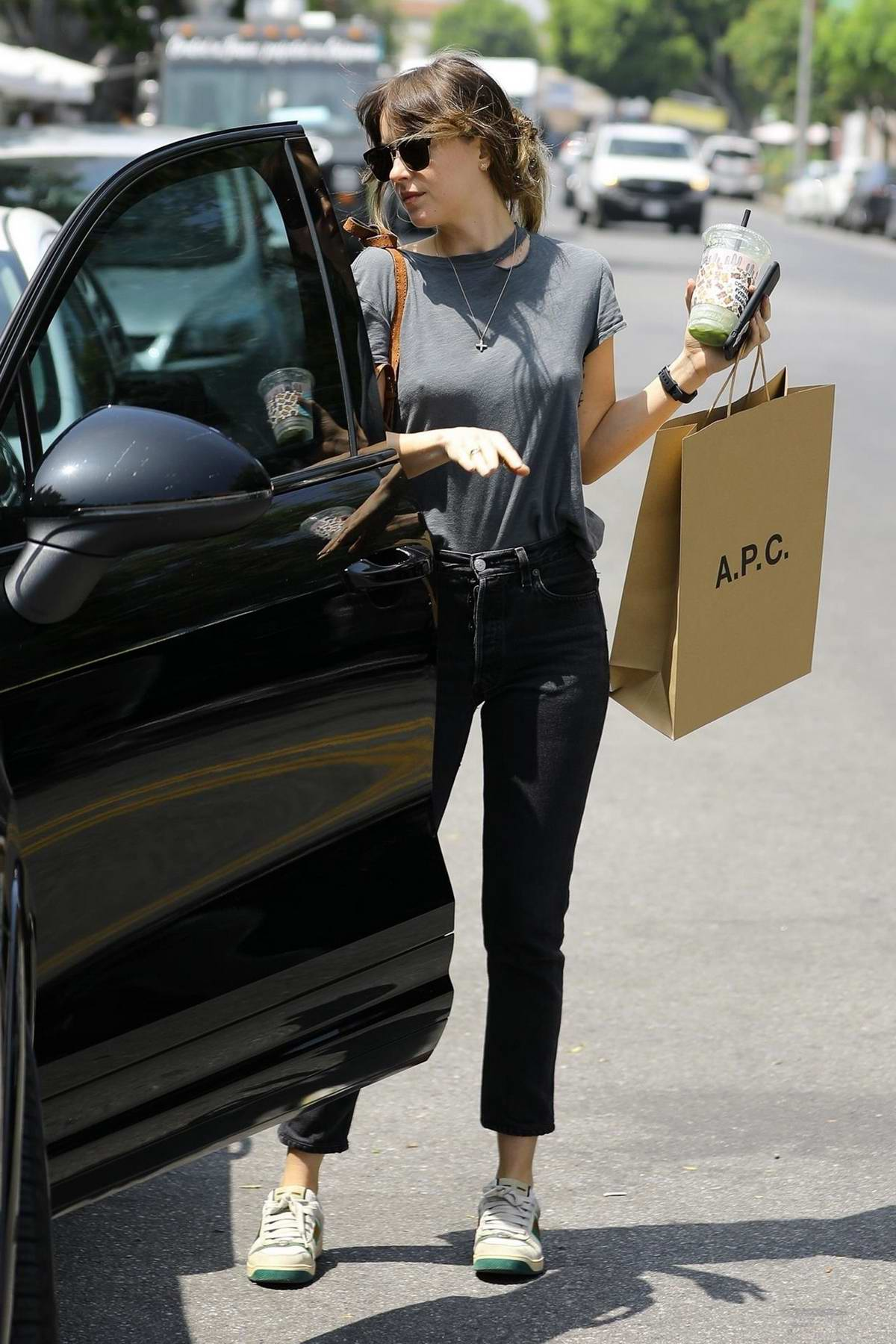 126ab98b9 dakota johnson wears grey top, black jeans and gucci sneakers during a  shopping trip to apc in los angeles-260419_8