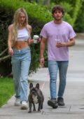 Delilah Hamlin flaunts her toned midriff in a white crop top while out for a stroll through West Hollywood, Los Angeles