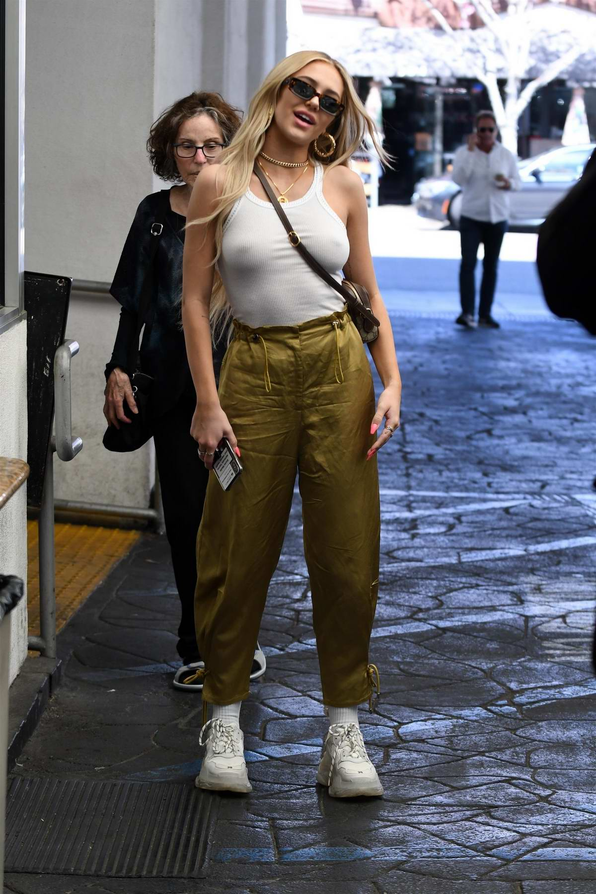 Delilah Hamlin rocks a white tank top and olive green pants as she steps out after lunch at E Baldi in Beverly Hills, Los Angeles