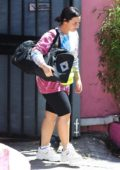 Demi Lovato wears Tie Dye and black leggings shorts as she carries her duffel bag while exiting the gym in Los Angeles