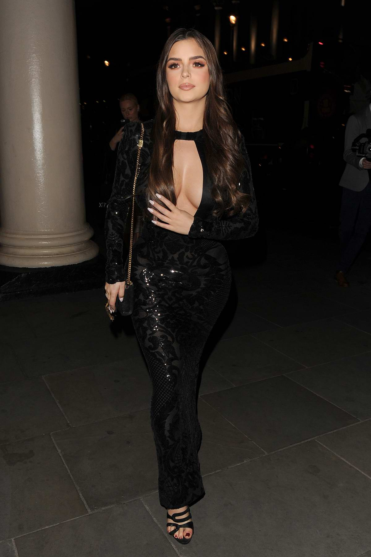 Demi Rose stuns in a plunging black dress during a night out in Mayfair, London, UK