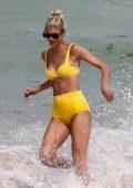 Devon Windsor dons a yellow bikini as she hits the beach with Olivia Culpo in Miami, Florida