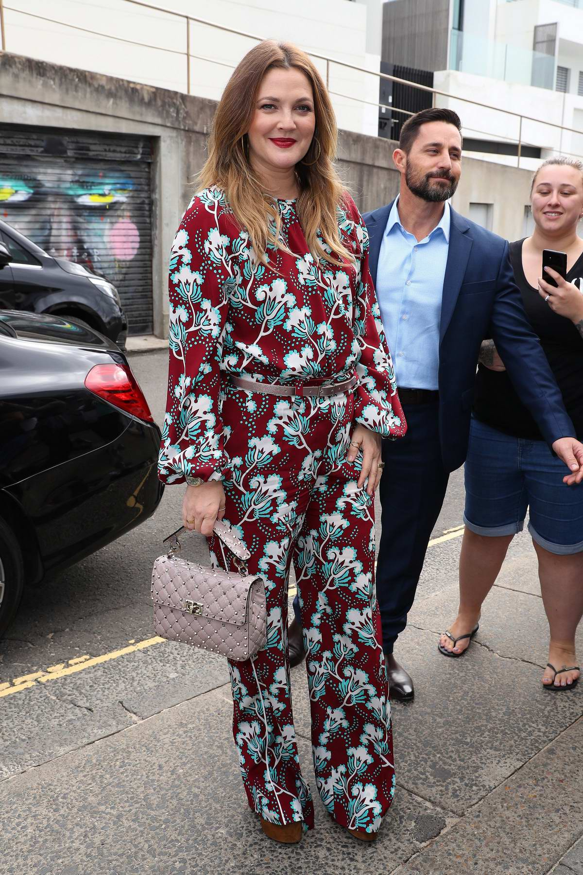 Drew Barrymore is all smiles as she arrives to her Flower Beauty Event in Sydney, Australia