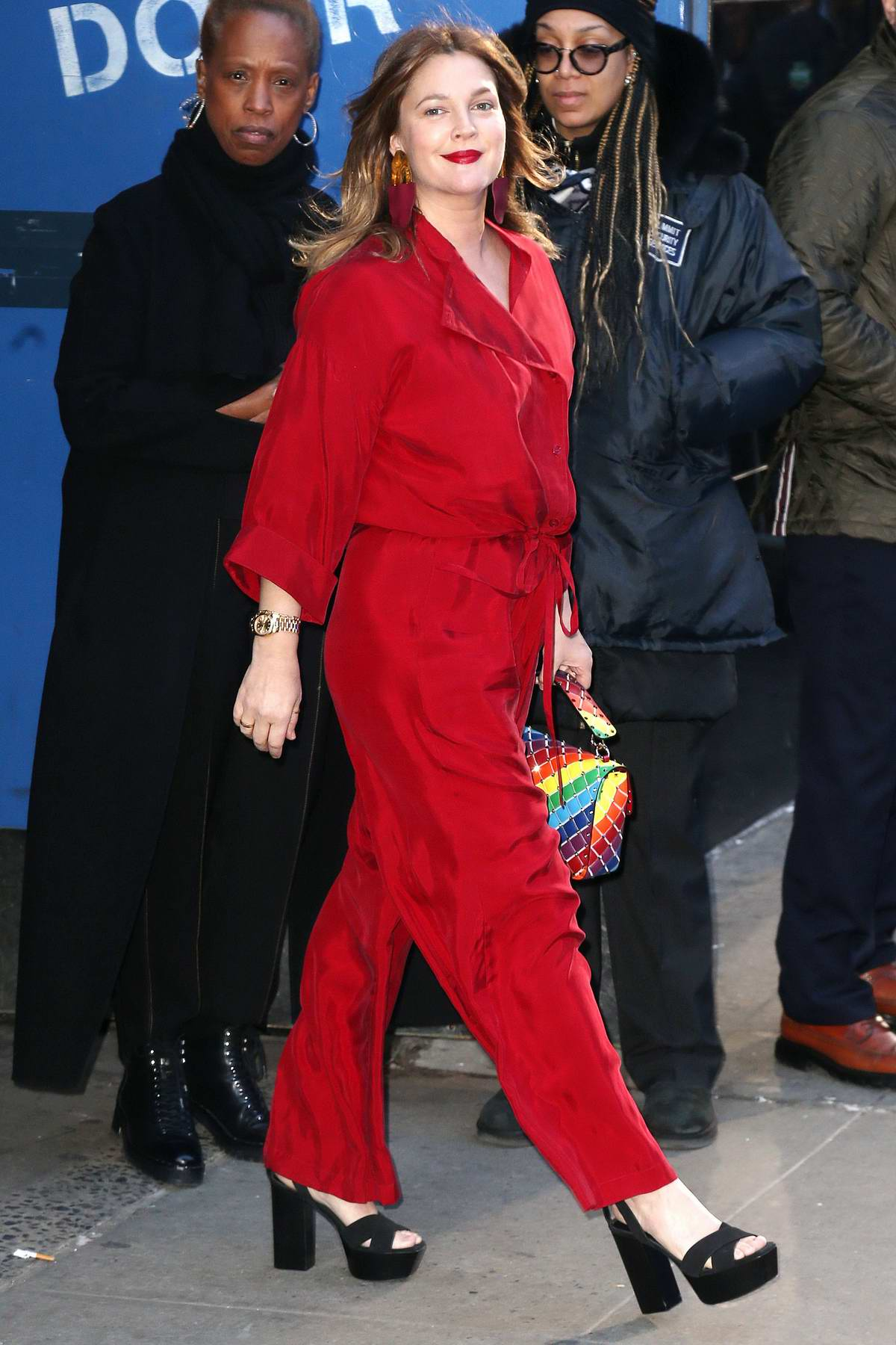 Drew Barrymore looks striking in a bright red jumpsuit as she visits Good Morning America in New York City