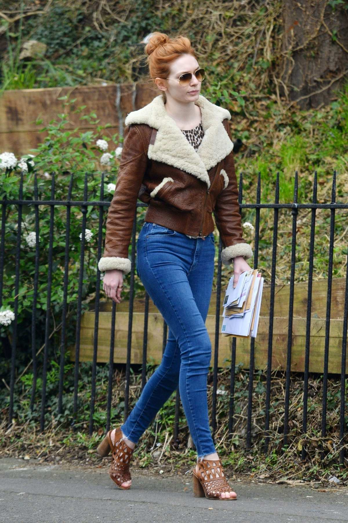 Eleanor Tomlinson looks stylish a fur-lined brown leather jacket and skin tight jeans while running a few errands in London, UK