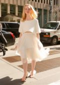 Elle Fanning looks angelic in all white while out and about in New York City