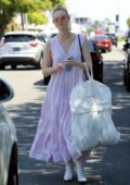 Elle Fanning looks pretty in a flowing pastel purple dress while out shopping in West Hollywood, Los Angeles