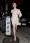 Elle Fanning looks pretty in a pink floral dress while out on a dinner date with Max Minghella at Criag's in West Hollywood, Los Angeles