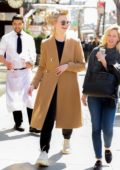 Elle Fanning wears curlers while taking a stroll in New York City