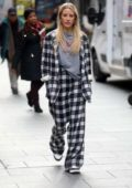 Ellie Goulding dons monochrome plaid as she arrives at Global Radio Studios in London, UK
