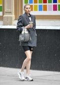 Elsa Hosk keeps it trendy in a grey blazer, black bike shorts and Adidas trainers during a coffee run in New York City