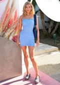 Elsa Hosk looks pretty in a blue mini dress at the Revolve Festival at Coachella in Indio, California