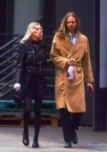 Elsa Hosk vapes as she and her boyfriend Tom Daly walk arm in arm in Soho, New York City