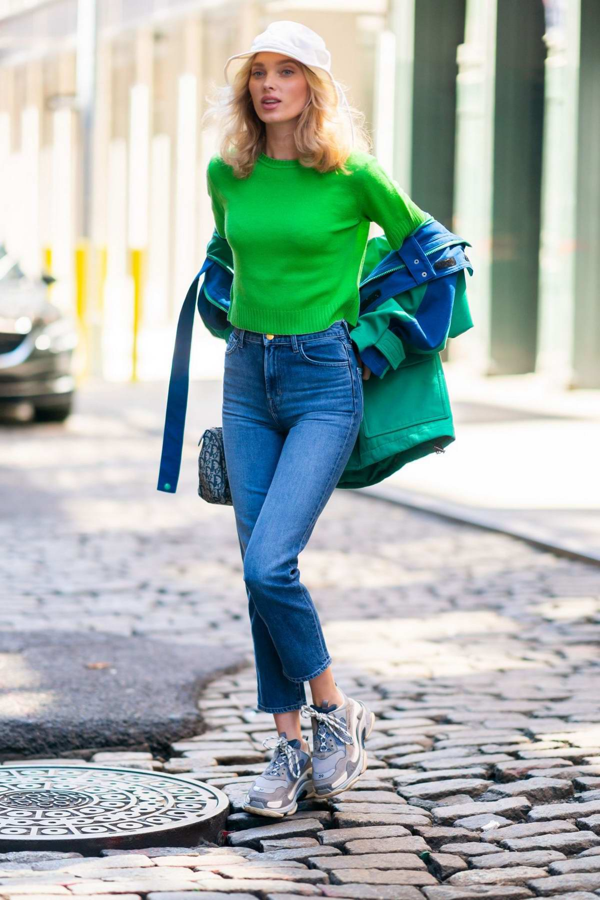 Elsa Hosk wears a bright green top paired with Balenciaga jacket for a outing in New York City