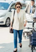 Emilia Clarke is all smiles after her parents drops her off at Heathrow Airport in London, UK